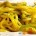spaghettoni con fiori di zucca e curcuma